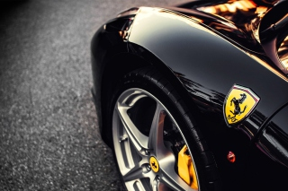 Black Ferrari With Yellow Emblem Background for Android, iPhone and iPad
