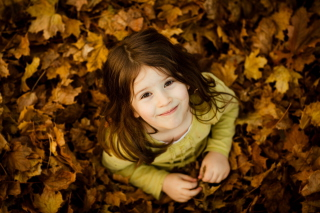 Child In Leaves Wallpaper for Android, iPhone and iPad