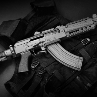 Bulletproof Vest and Machine Gun - Obrázkek zdarma pro iPad Air