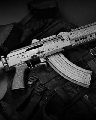 Bulletproof Vest and Machine Gun - Obrázkek zdarma pro Nokia C1-01