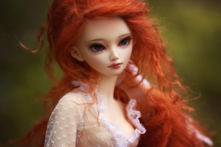 Gorgeous Redhead Doll With Sad Eyes Background for Android, iPhone and iPad