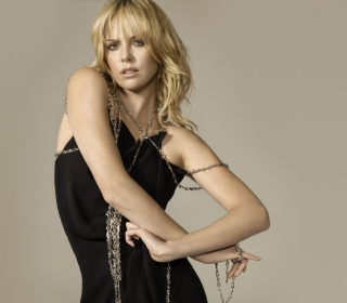 Charlize Theron In Little Black Dress - Obrázkek zdarma pro 128x128