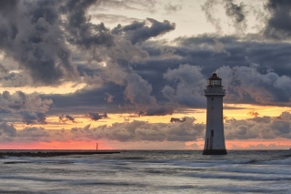 Free Massive Clouds Above Lighthouse Picture for Android, iPhone and iPad