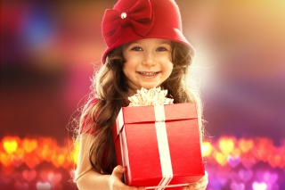 Free Happy Child With Present Picture for Android, iPhone and iPad