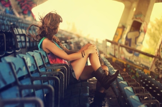 Girl Sitting In Stadium Picture for Android, iPhone and iPad