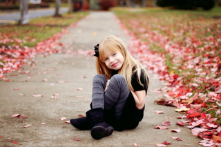 Little Blonde Girl In Autumn Park Background for Android, iPhone and iPad