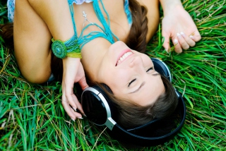 Smiling Girl Listening To Music Picture for Android, iPhone and iPad