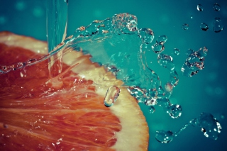 Orange Slice In Water Drops Wallpaper for Android, iPhone and iPad