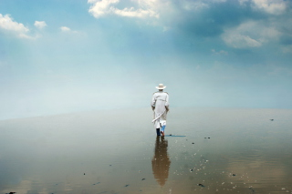 Free Man In White Hat Walking On Water Picture for Android, iPhone and iPad