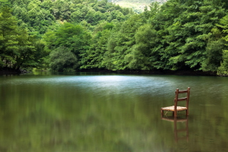 Chair In Middle Of Pieceful Lake Picture for Android, iPhone and iPad