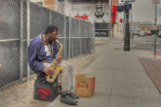 Jazz saxophonist Street Musician Background for Android, iPhone and iPad