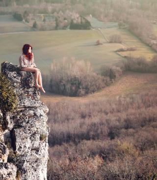 Redhead Girl Sitting On Rock - Obrázkek zdarma pro Nokia C2-00