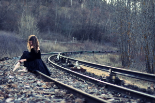Girl In Black Dress Sitting On Railways Picture for Android, iPhone and iPad