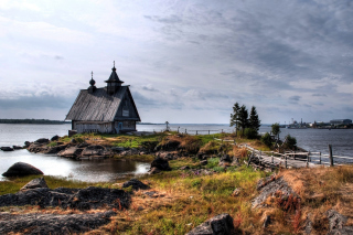Old small house on the rocky river shore Picture for Android, iPhone and iPad
