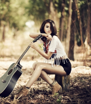 Pretty Brunette Model With Guitar At Meadow - Obrázkek zdarma pro Nokia 206 Asha