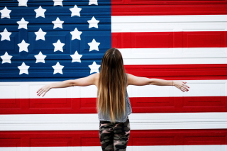 American Girl In Front Of USA Flag Wallpaper for Android, iPhone and iPad