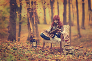 Girl Reading Old Books In Autumn Park Wallpaper for Android, iPhone and iPad