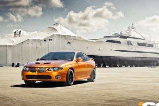 Orange Pontiac GTO In Port Ship Picture for Android, iPhone and iPad