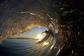 Free Surfer Against Big Wave Picture for Android, iPhone and iPad