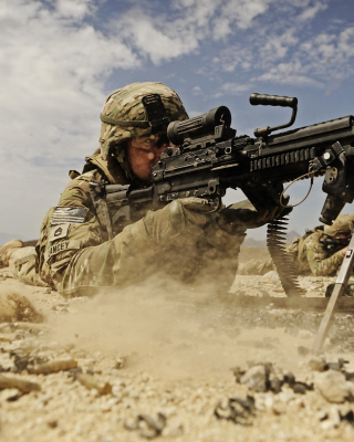 Soldier with M60 machine gun Wallpaper for Nokia Asha 305