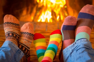 Happy family near fireplace Background for Fly Levis