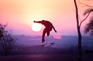 Sunset Skateboard Jump Picture for Android, iPhone and iPad
