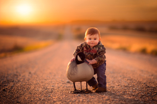 Funny Child With Duck Picture for Android, iPhone and iPad