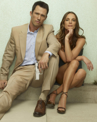 Burn Notice TV Series with Gabrielle Anwar as Fiona Glenanne and Jeffrey Donovan as Michael Westen Background for HTC Titan