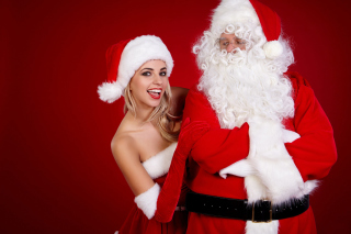 Kostenloses Santa Claus and Cute Blonde Snow Maiden Wallpaper für Samsung Galaxy Tab 3 10.1