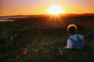 Little Boy Looking At Sunset From Hill Wallpaper for Android, iPhone and iPad