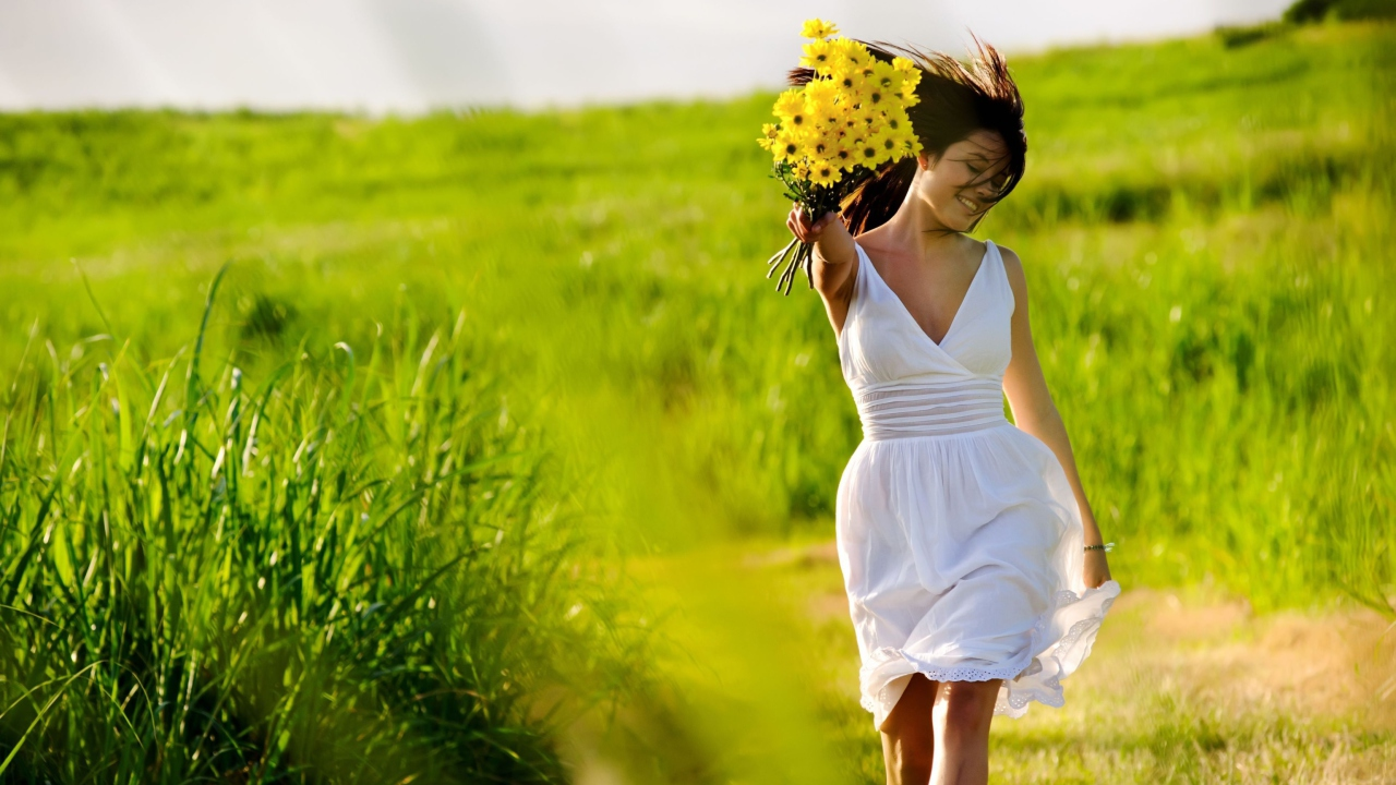 Girl With Yellow Flowers In Field