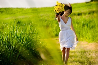 Girl With Yellow Flowers In Field Picture for Android, iPhone and iPad