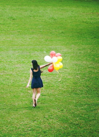 Girl With Colorful Balloons In Green Field Picture for Nokia C1-01