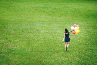 Girl With Colorful Balloons In Green Field Background for Android, iPhone and iPad