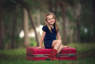 Little Girl Sitting On Red Suitcase - Obrázkek zdarma