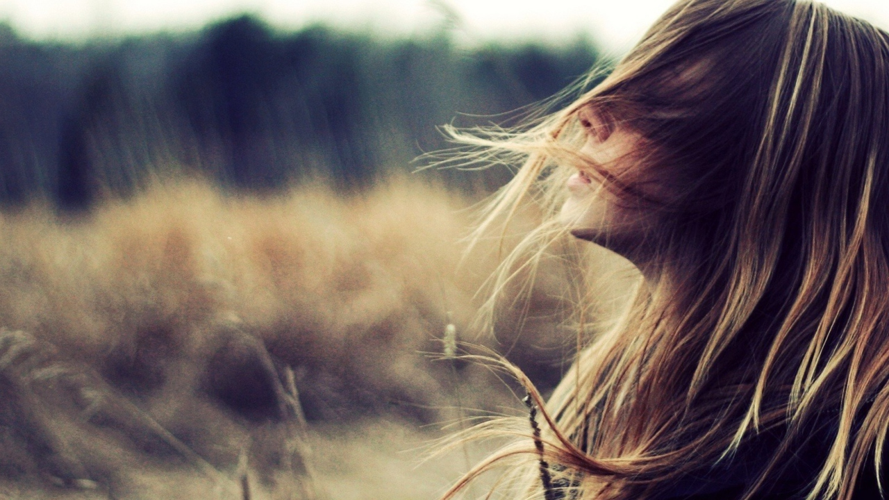 Beautiful Girl With Wind In Her Hair
