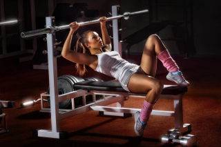 Sport Girl In Gym Background for Nokia Asha 200