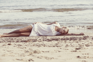 Blonde Girl Lying On Beach Background for Android, iPhone and iPad