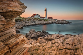 Lighthouse On Rocky Seashore Background for Android, iPhone and iPad