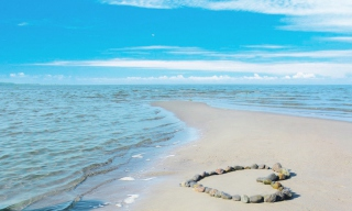 Heart Of Pebbles On Beach Background for Android, iPhone and iPad