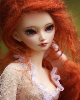 Free Gorgeous Redhead Doll With Sad Eyes Picture for Nokia Asha 311