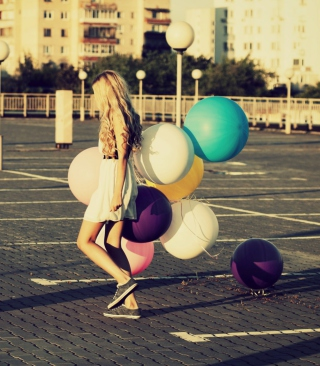 Free Happy Girl With Colorful Balloons Picture for Nokia C1-01