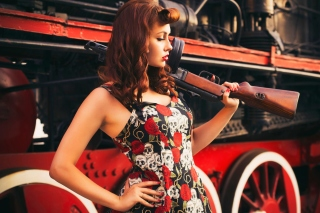 Pin up model with Gun sfondi gratuiti per Nokia XL