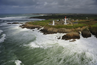 Free Lighthouse On Hill And Big Waves Picture for Desktop Netbook 1024x600