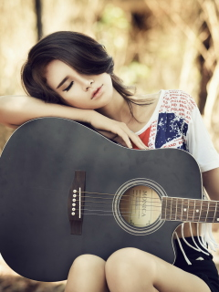 Screenshot №1 pro téma Pretty Girl With Guitar 240x320