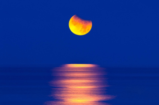 Free Orange Moon In Blue Sky Picture for Android, iPhone and iPad