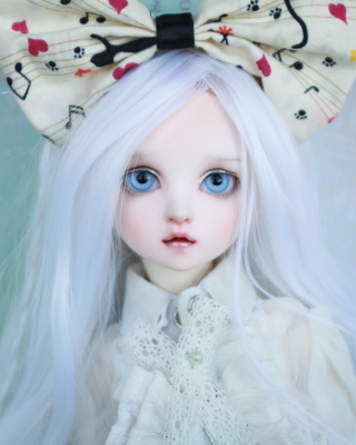 Blonde Doll With Big Bow Background for Nokia C1-01