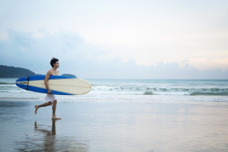 Free Guy Running With Surf Board Picture for Android, iPhone and iPad