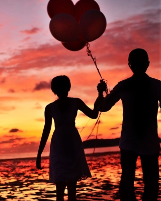 Couple With Balloons Silhouette At Sunset Background for HTC Titan