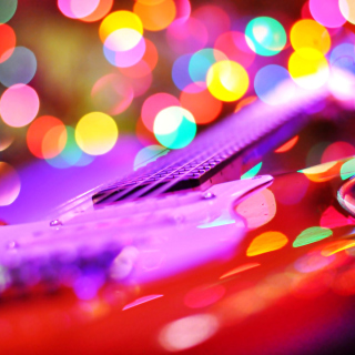 Free Bokeh Guitar Picture for iPad 3